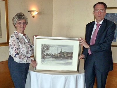 James Thewliss being presented with a painting